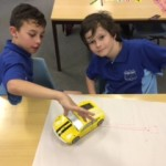 Cailen and Jeremy have programmed the Probot to draw and drive.